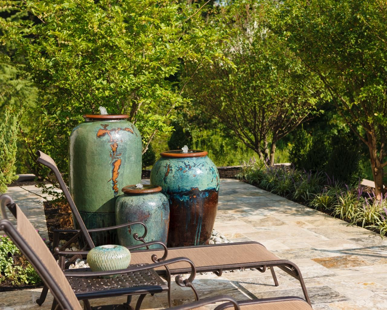 Wonderful A Trio Of Water Urns Are An Eye Catching Focal Point On This Patio.