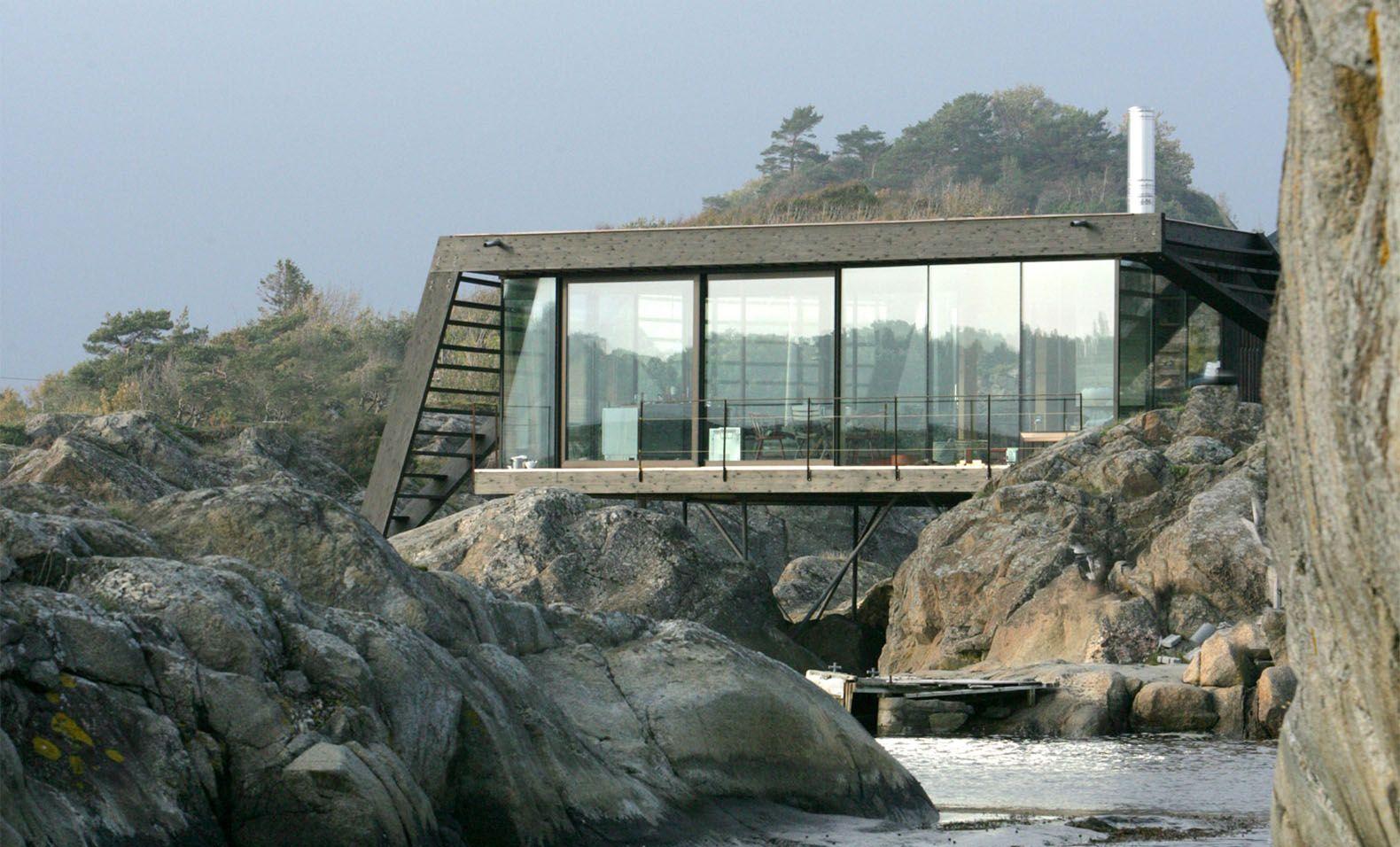 Tucked away norwegian island house on stilts is only for Log cabin homes on stilts