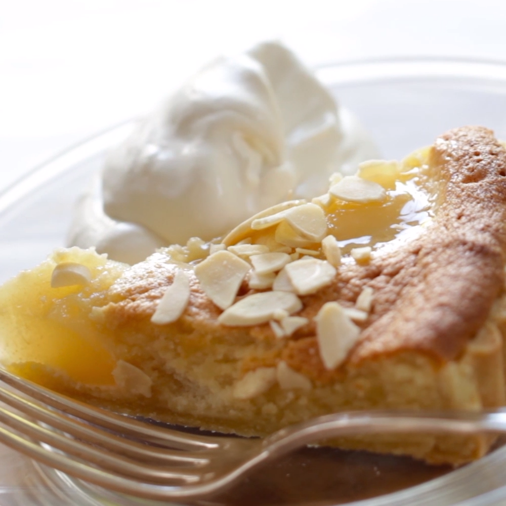 Pear Almond Tart Recipe! A delicate crust mixed with rich almond paste and tender pears. Such a winner! Includes video tutorial too.   #pearalmondtartrecipe #frenchpearalmondtart #easypearalmondtart #entertainingwithbeth
