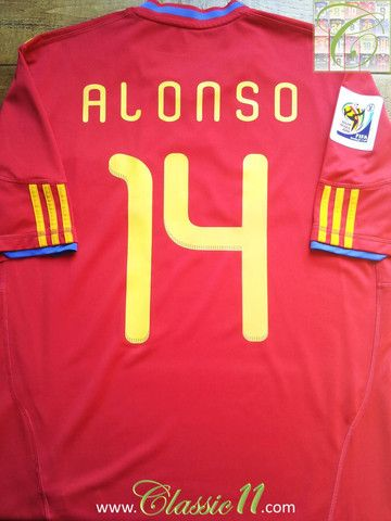 7cab20a2c Relive Xabi Alonso s 2010 World Cup with this vintage Adidas Spain home  football shirt.