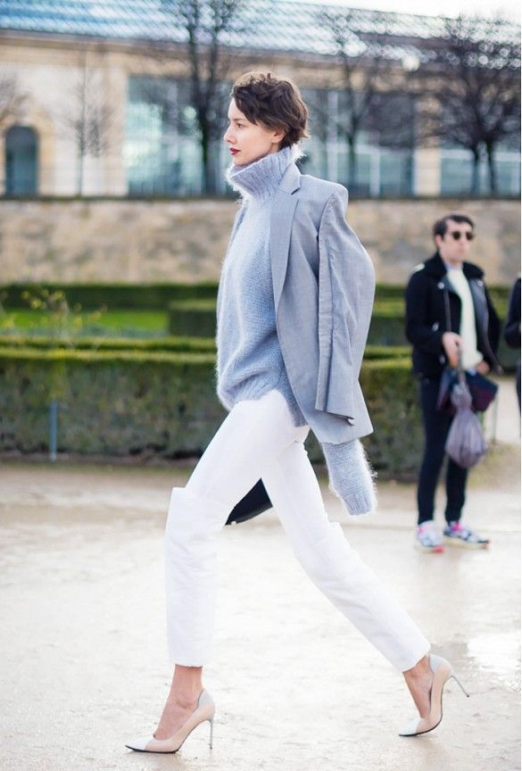 White jeans are paired with a turtleneck sweater, a blazer, white ...