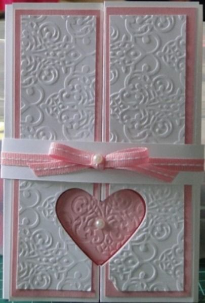 Punched Double GatefoldFinal -  Technique tutorial here - http://libbystampz.blogspot.com.au/2013/05/punched-double-gatefold-technique.html Card - Whisper White and Pretty in Pink Simply Scored Big Shot - Textured Impressions Folder - Lacy Brocade Punch - Full Heart Adhesive - Snail, Glue Dots and Sticky Strip Basic Jewels - Pearl Ribbon - Pretty in Pink Stitched Grosgrain