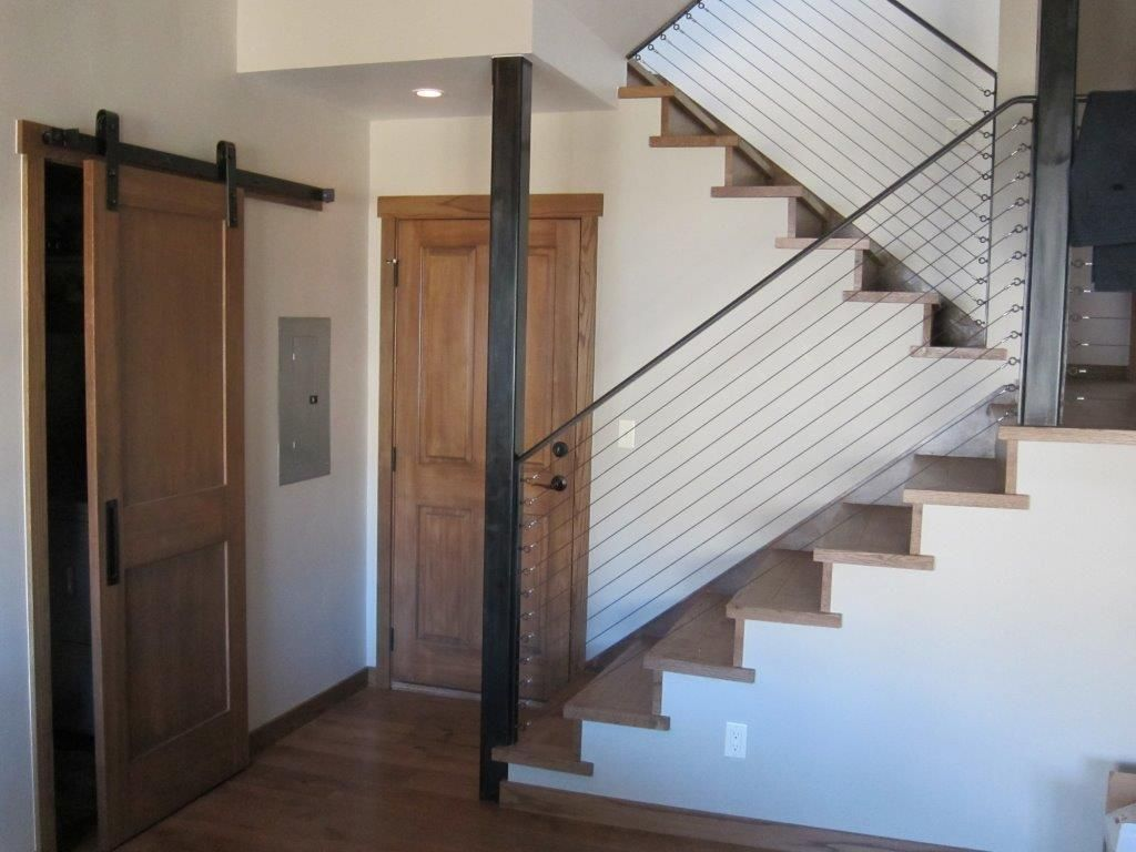 The finished stair case and steel cable rail. The stair treads are ...