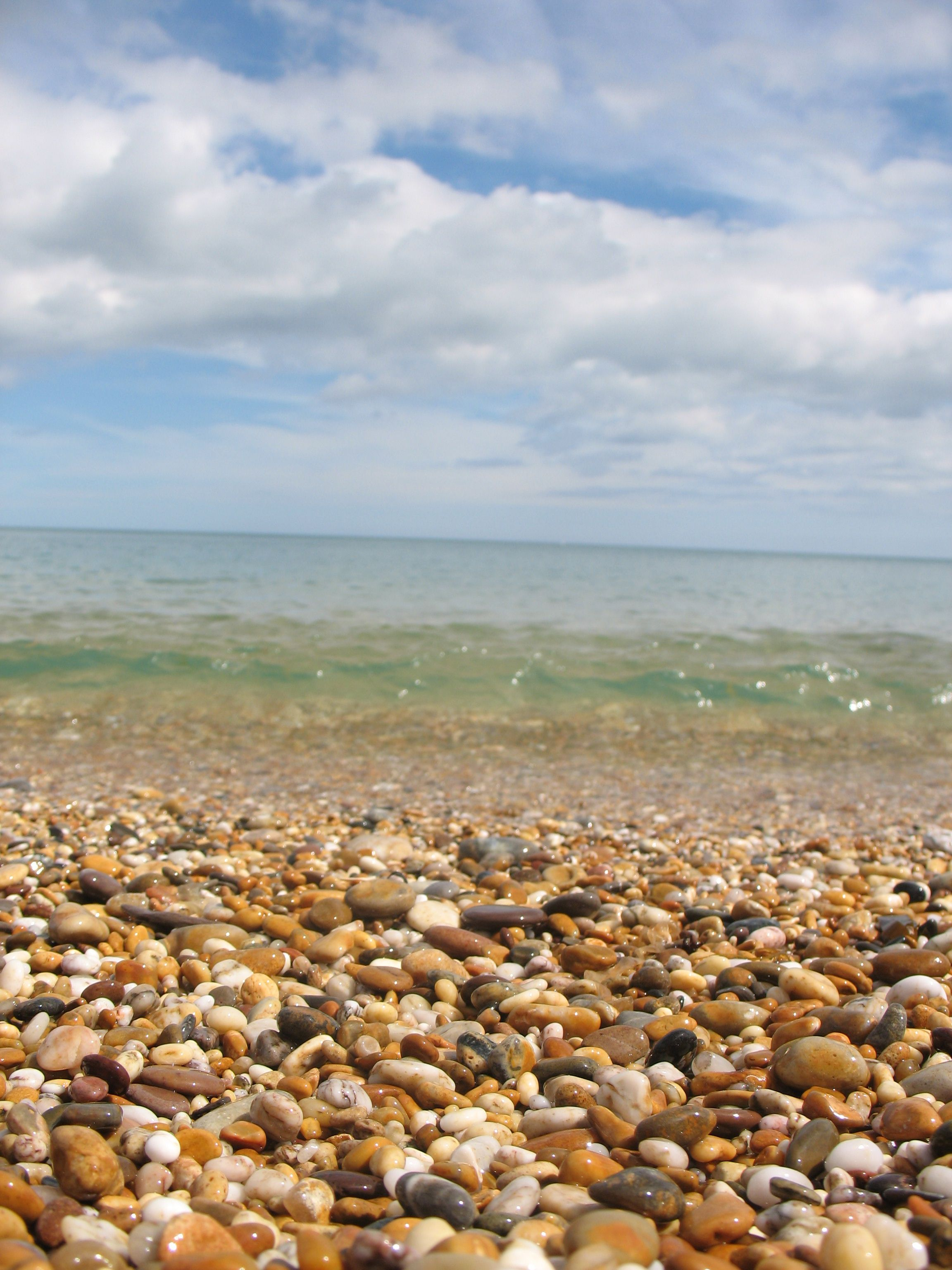 i love the sound of the sea as it rushes over the pebbles rh pinterest com