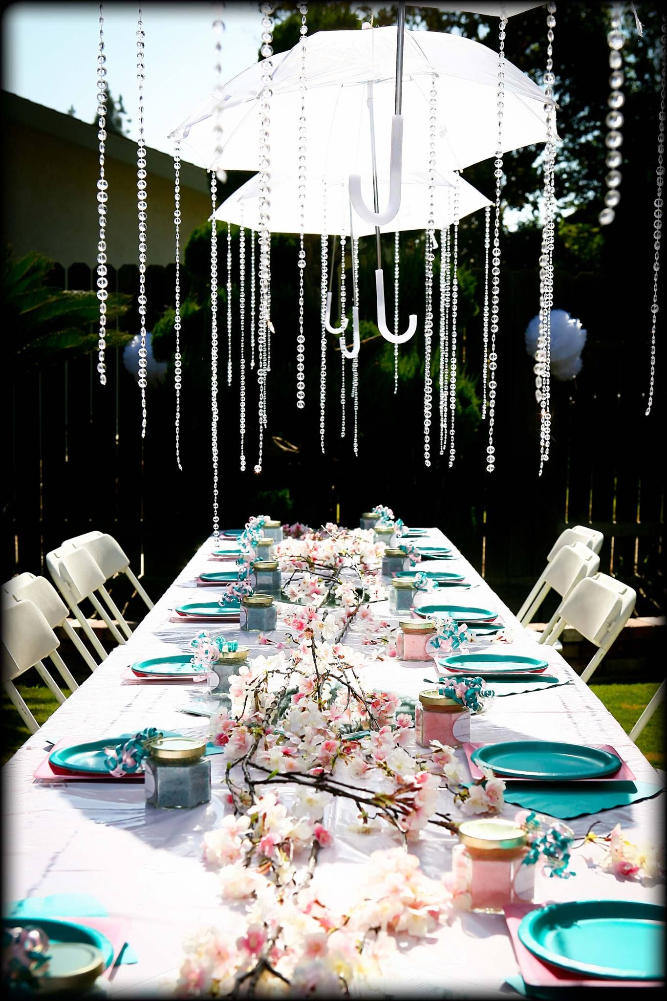 Umbrellas showering down crystals for baby shower decor
