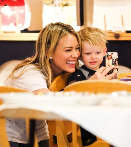 Cheese!  Lizzie McGuire alum Hilary Duff smiled for a selfie with her sweet son Luca, nearly 2, in Los Angeles, Calif. on Friday (March 7). The adorable duo enjoyed some creative time at Color Me Mine.