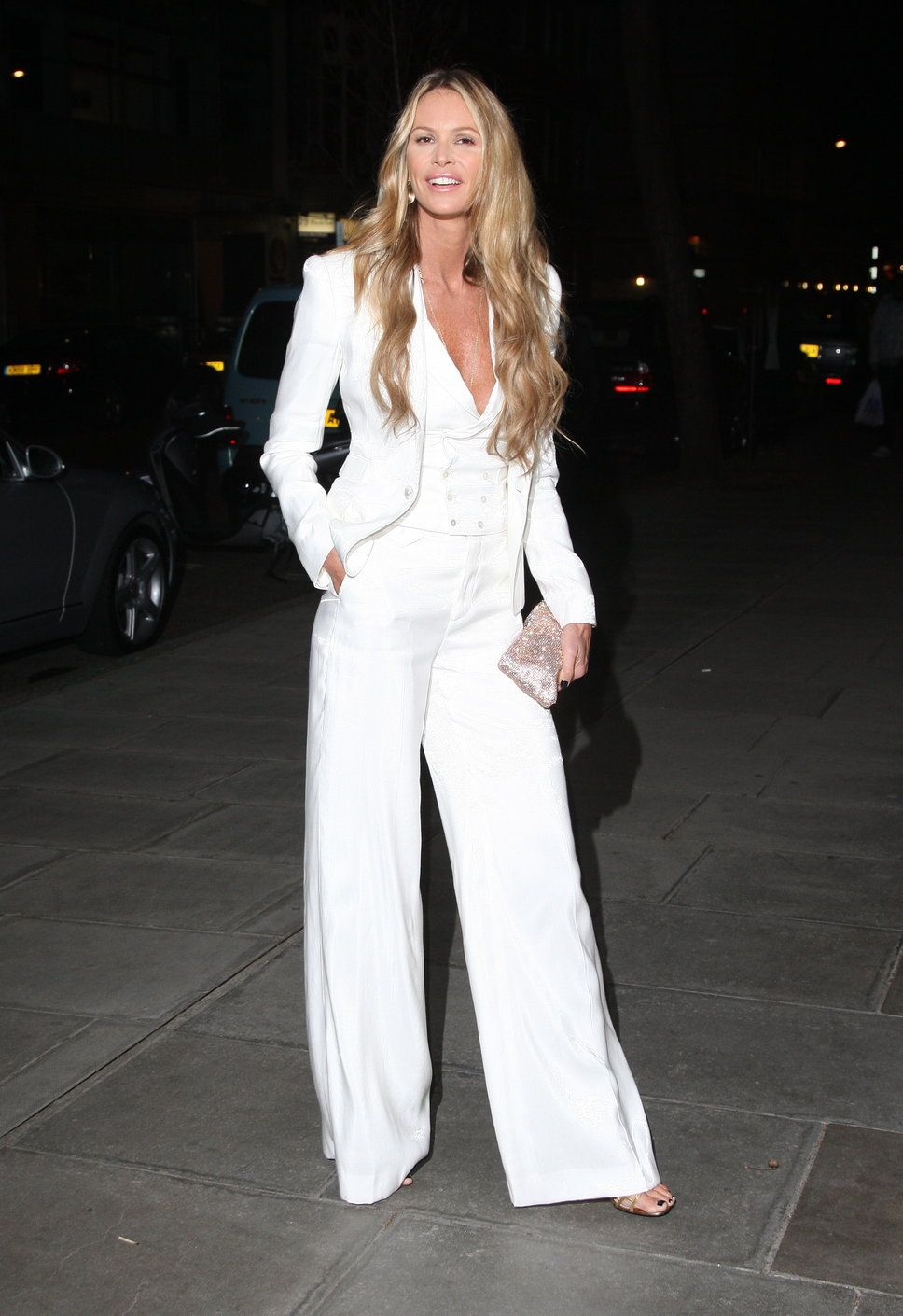 Elle MacPherson, white suit, pants with high waist and wide legs ...