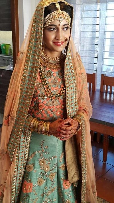 Bridal Wear - Pastel Shades Lehenga | WedMeGood | Peach and Blue Pastel Lehenga with Threadwork, Peach Net Dupatta and Gold Jewelry #lehenga #wedmegood #indianbride #pastel #indianwedding #sikhbride #pastelshades