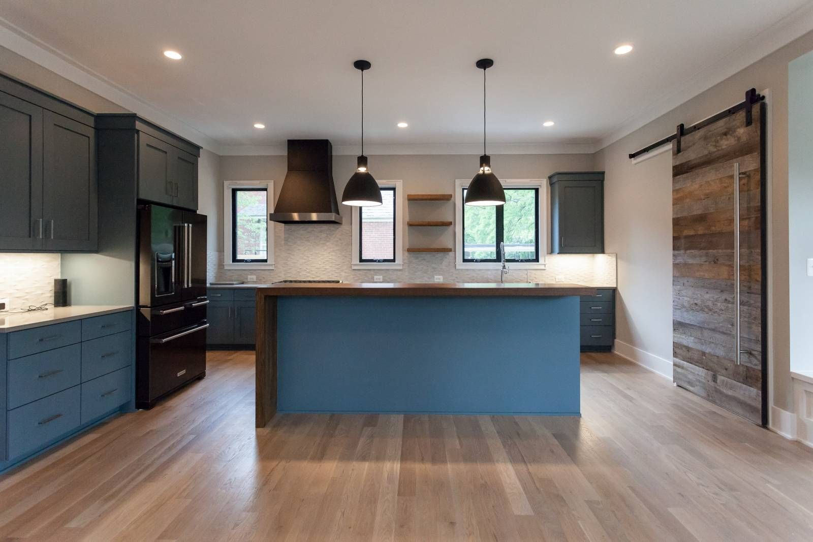 Contemporary Modern Kitchen With Slate Blue Cabinets And Reclaimed Wood Bar Counter And Black A Black Kitchens Black Appliances Kitchen Kitchen Renovation Cost