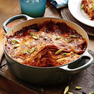 This recipe layers corn tortillas, chicken and three kinds of cheese into one hearty casserole.