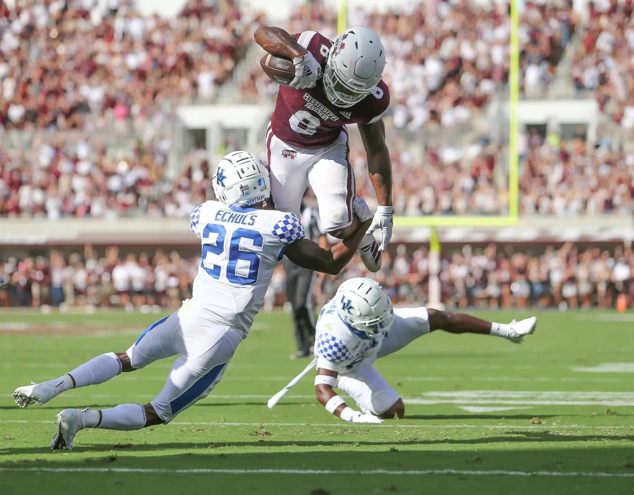 Mississippi State's Kylin Hill (8) jumps over Kentucky's