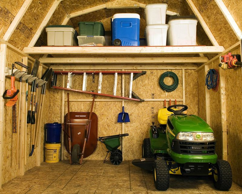 Traditional garage and shed by backyard buildings shed for Garden shed organisation