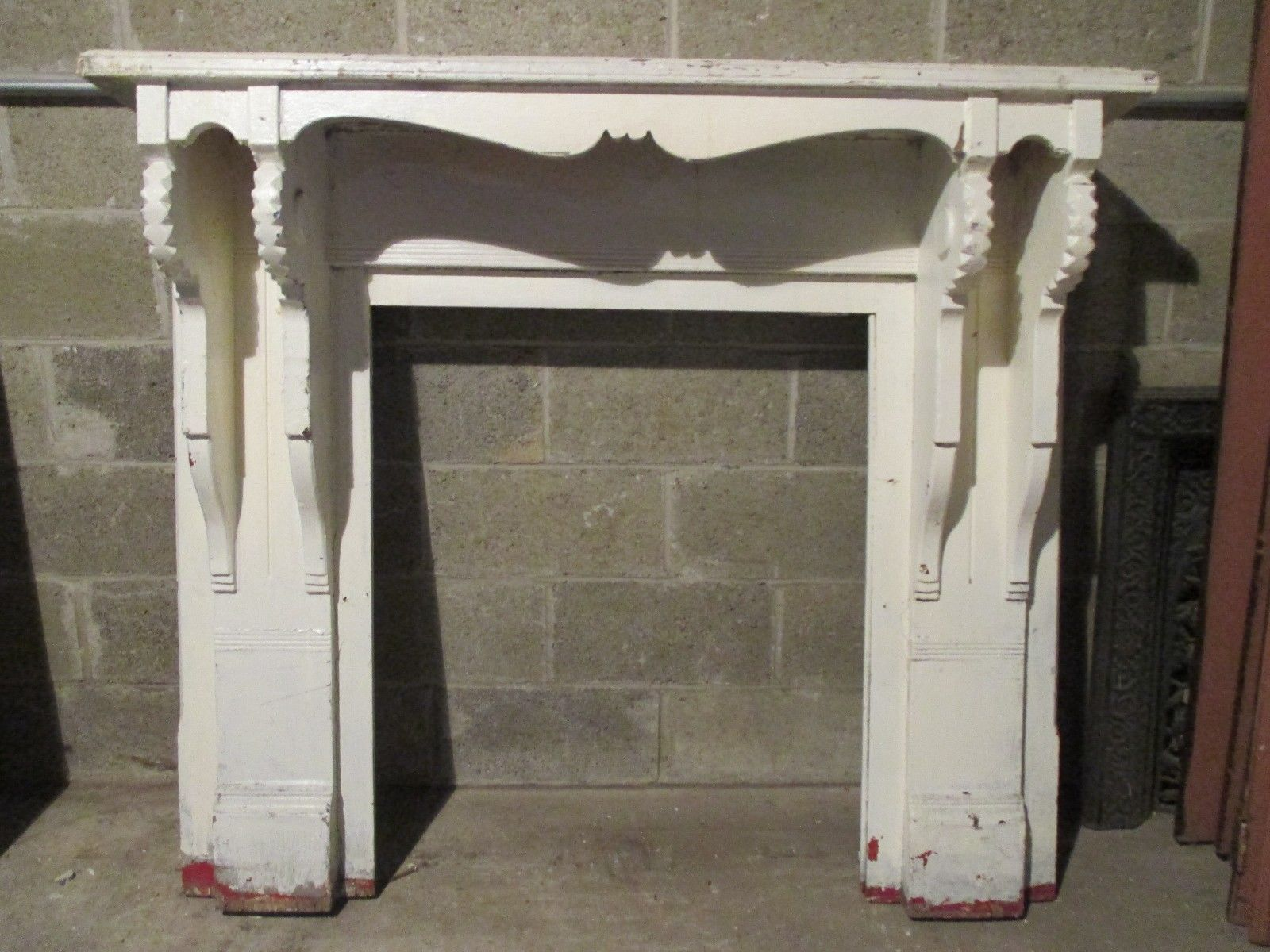 christy brinkelys fireplace covered in shells