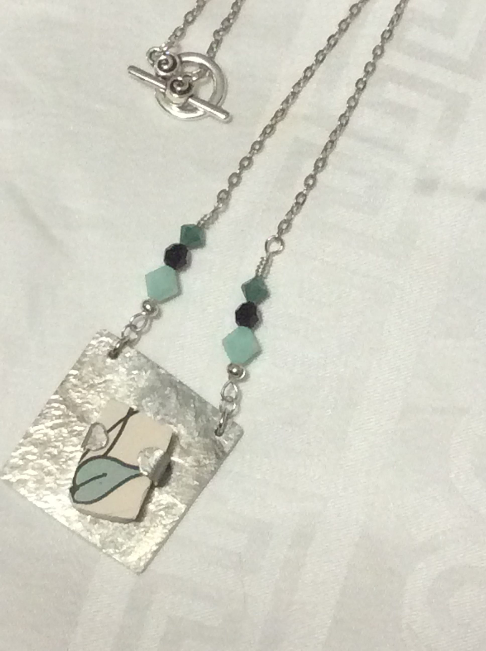 Pewter, ceramic, Swarovski crystals and plated metal necklace.