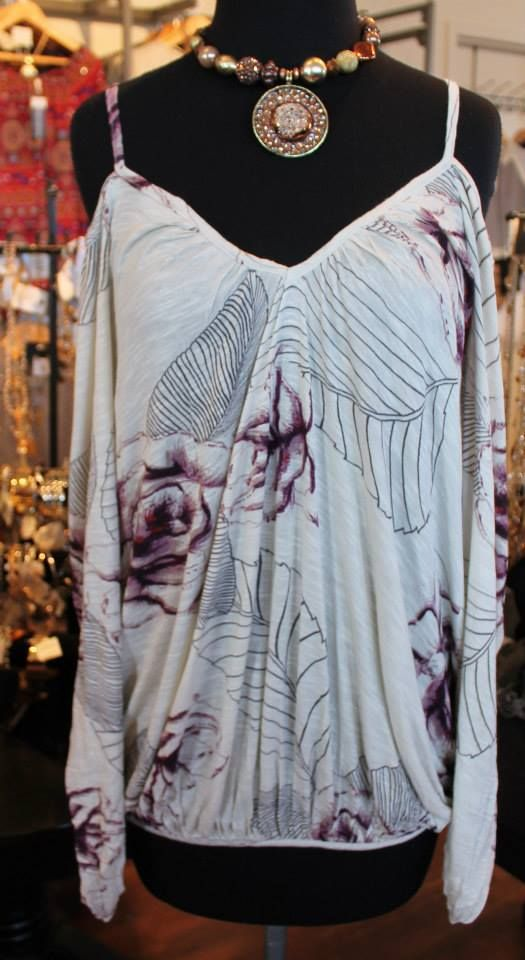 Free People cold shoulder top in off white and deep plum floral pattern! So unique. #freepeople XS-M $78.00