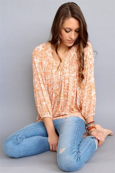 We love the slouchy fit of this Free People Sunset Combo Moss Printed Top. Shop now at Rosie True. #spring #floral #freepeople