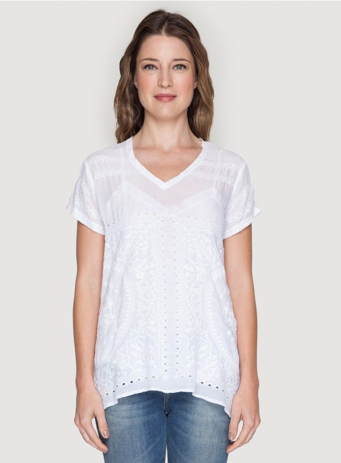 Scalloped V-Tee The Johnny Was SCALLOPED V-TEE offers a bohemian take on the staple t-shirt thanks to a flowy fabrication and subtle tonal embroidery and eyelet detailing. Tuck this boho tee into your favorite jean shorts and finish your look with gladiator sandals and plenty of jewelry!  - Rayon Georgette - V-Neckline, Cap Sleeves - Signature Embroidery and Eyelet Detailing - Care Instructions: Machine Wash Cold, Tumble Dry Low