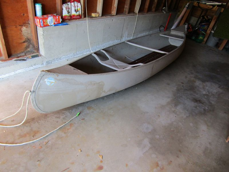 Grumman aluminum canoe, 13 feet long in good condition
