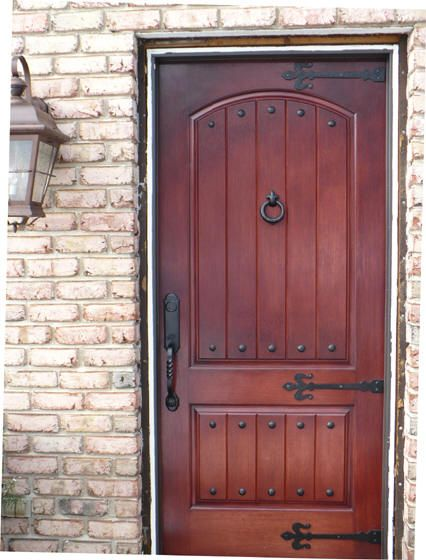 Old World Entry Door With Dummy Strap Hinges And Metal Nails Doors