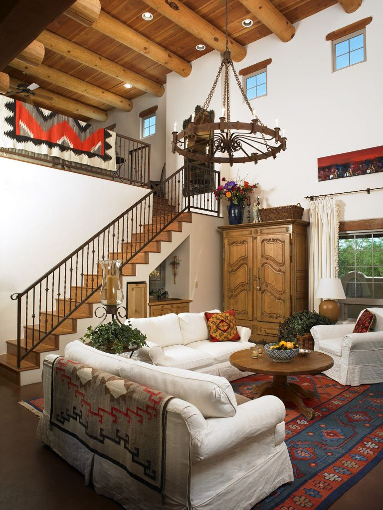 The furnishings combine southwestern country wood pieces with copper, Navajo rugs, old Pima and Apache baskets, leather and soft organic fabrics.