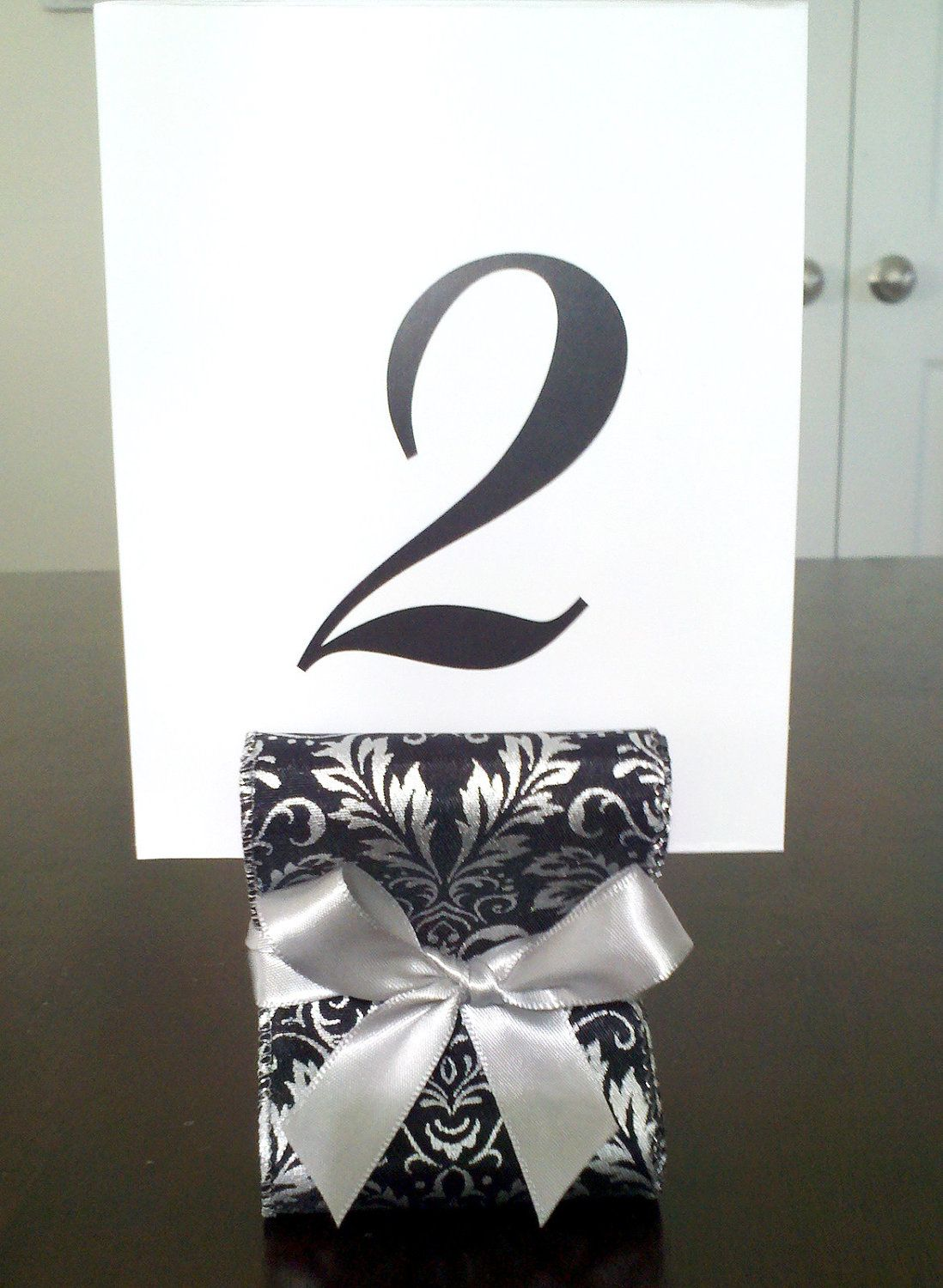 Wedding Table Number Holders - Set of Ten (10) with Black and Silver Damask Satin Ribbon - Customize Accent Ribbon. $35.00, via Etsy.