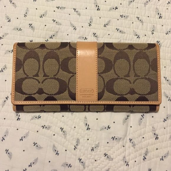 Coach wallet Brand new, authentic coach wallet. It was a gift and has never been used. Coach Bags Wallets