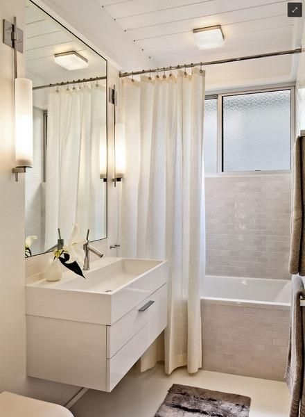 Contemporary White Bathroom With Subway Tiles And An Extra Long Shower Curtain Hung Close To The Ceiling Making Look HUGE
