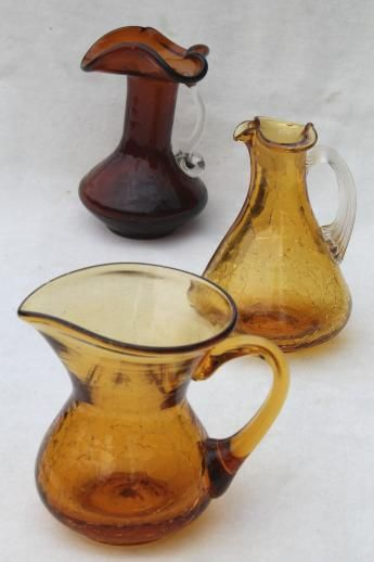 vintage crackle glass pitchers - all amber glass