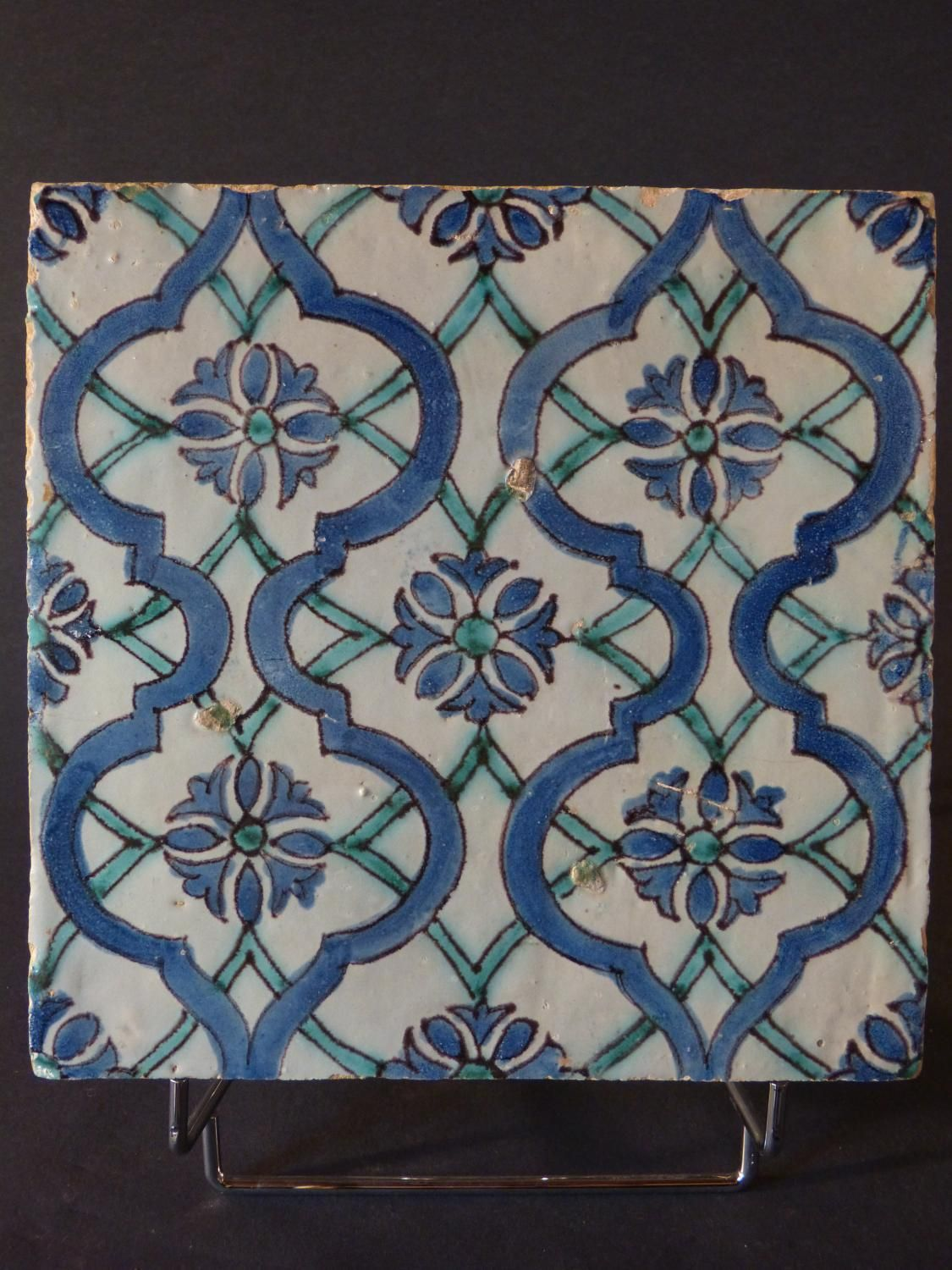 Antique for sale iran pottery fleur de lys ceramic persian vase antique for sale safavid persian ceramic tile with arabesques in earthenware ground stone tile pavement floor dailygadgetfo Images