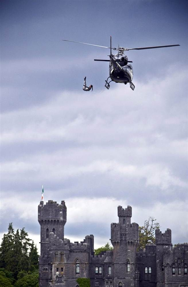 Orlando Duque of Colombia dives 23 meters from a helicopter next to Ashford Castle during a training session in build up to the 2012 Red Bull Cliff Diving World Series at Cong, Ireland on Monday, June 11.
