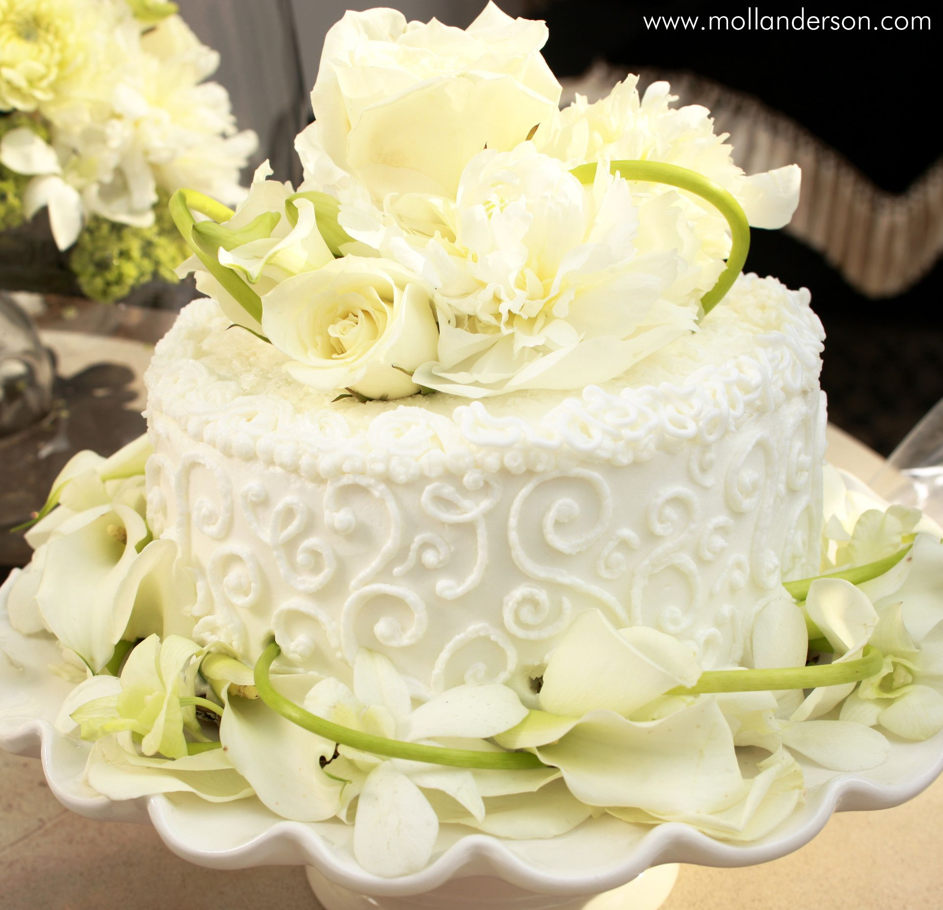 By sticking fresh white flowers (calla lilies, peonies, roses ...