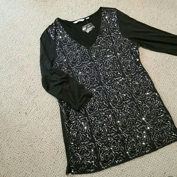 Gray Sequined Top Isaac Mizrahi Live! gray top with gunmetal sequins on front. Back is plain. 3/4 length sleeves.  Comes with extra sequins. 95% rayon knit, 5% Spandex for a little stretch. Front has lining so the sequins don't itch! Size medium, could fit a large. New, never worn. Isaac Mizrahi Tops