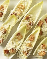 I love making elegant food like this!! Caesar Salad Spears  Salads usually require forks, but Grace Parisi transforms a classic Caesar into a clever finger food. She tosses chopped endives with a lemony dressing, then spoons the mixture inside elegant endive spears, topping it with cheese and crunchy mini croutons.