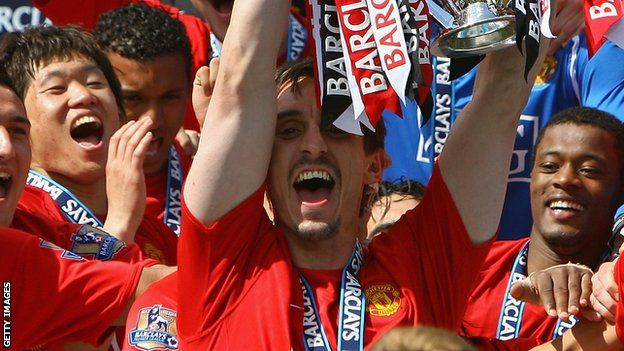 Gary Neville lifts the Premier League trophy for Manchester United
