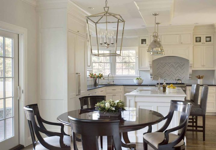 Eat In Kitchen Features Visual Comfort Lighting Darlana Medium Lantern Polished Nickel Over Round Brown Dining Table Surrounded By Chairs