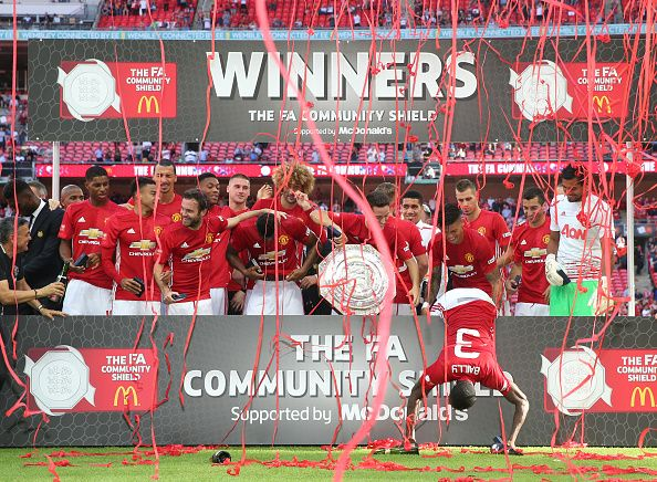 The Manchester United Squad Pose With The Community Shield Trophy After The Fa Community Shield Match Between Leicester City And