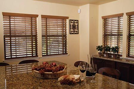 Use Wood Blinds To Echo The Look Of Your Cabinetry Throughout Your