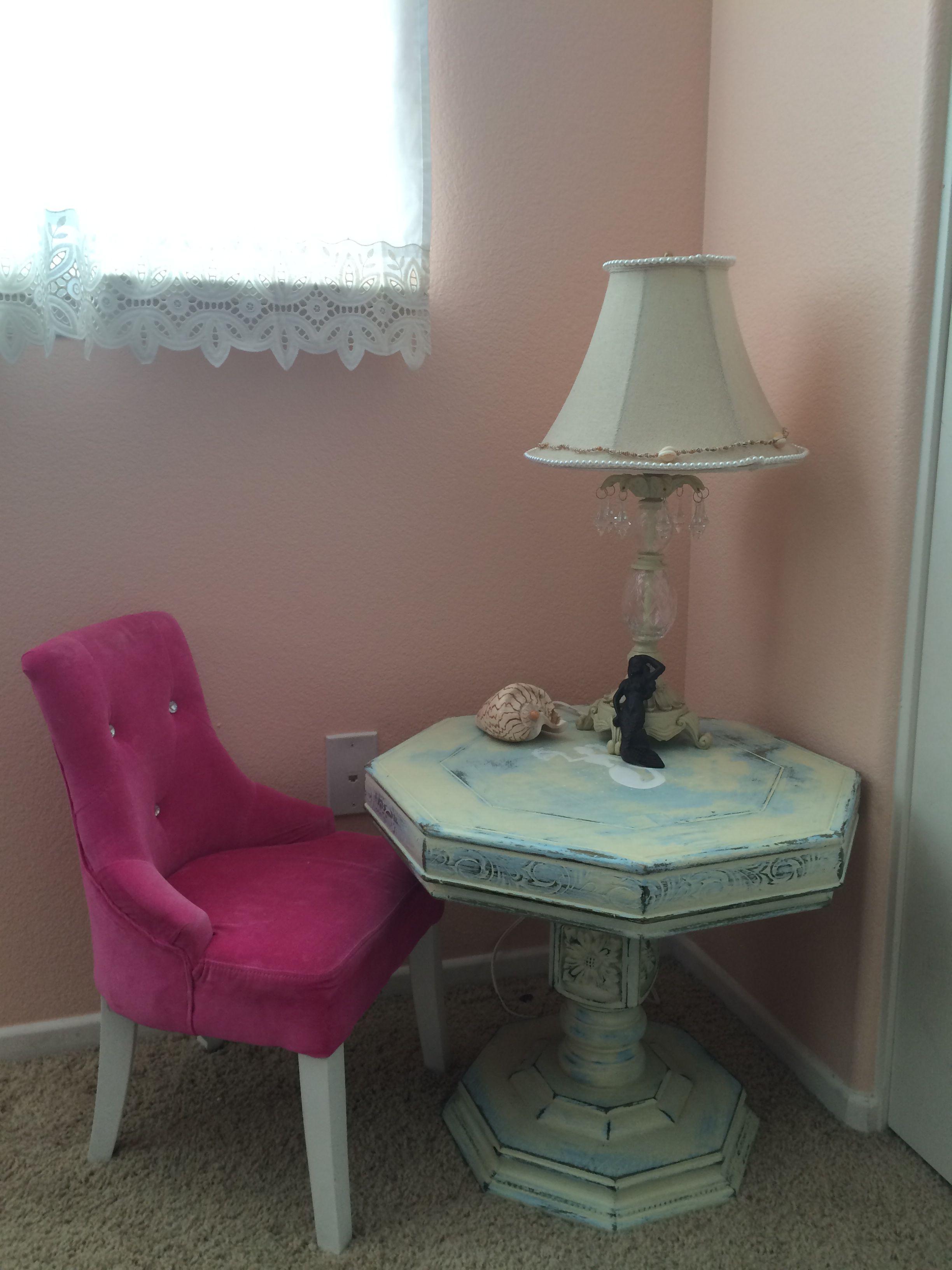 Reading nook in toddler vintage mermaid room.