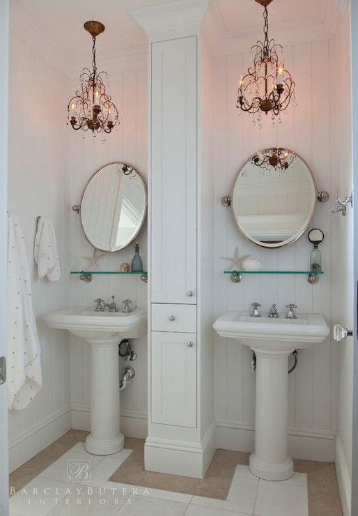 Stunning Cottage Bathroom Features Beadboard Clad Walls As A Backdrop To His And Her Pedestal Sinks