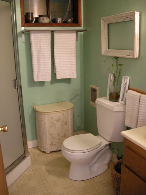 Green bathroom going coastal my new sea green bathroom for Green and brown bathroom set