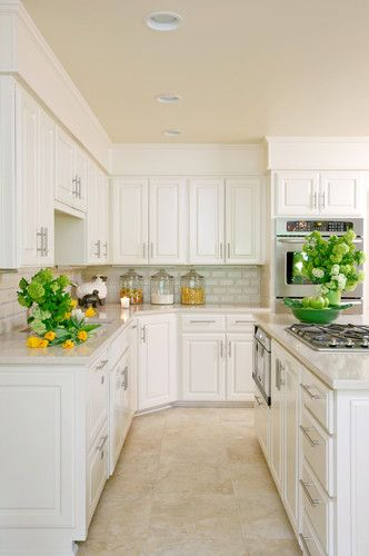 Kitchen With White Cabinets And Travertine Tile Floor Kitchen