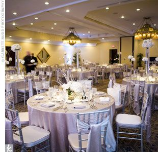 Ivory Wedding Receptions Guests Sat In Silver Chiavari Chairs At Reception Tables That Were Topped With Linens