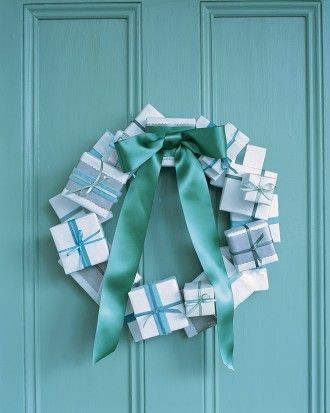 Unwrap a new wreath idea this year. Cover small containers, such as old jewelry boxes, with weatherproof paper, which will hold up outdoors, unlike wrapping paper; seal with all-weather tape. Add decorative bands in contrasting colors, if desired, and tie with ribbon. Attach to a flat wooden wreath form (ours is 18 inches) using a hot-glue gun. Affix a satin bow.