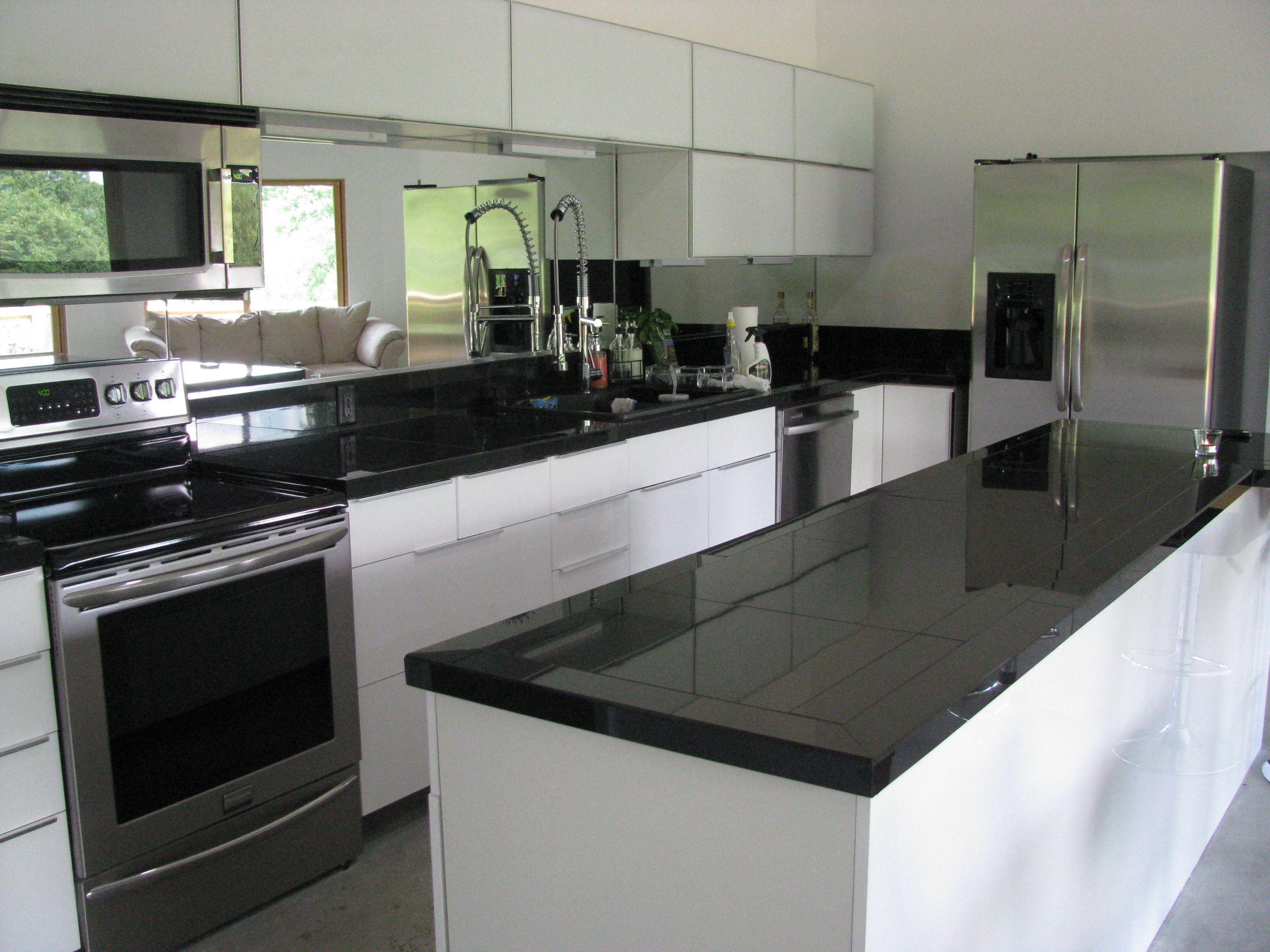 Love my IKEA cabinets, mirror backsplash and granite tile