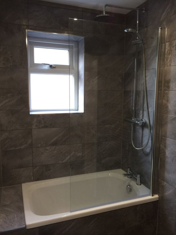 Short Bath With Shower Above Bathroom Installation In Leeds