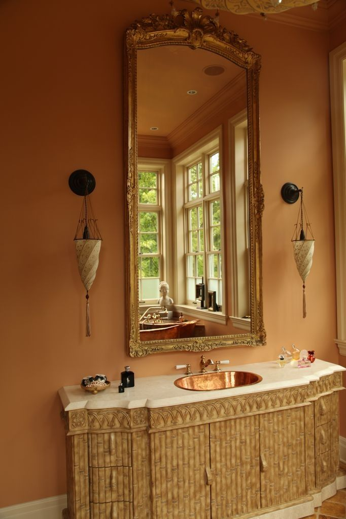 Glamorous country master bathroom. These wall sconces are so unique ...
