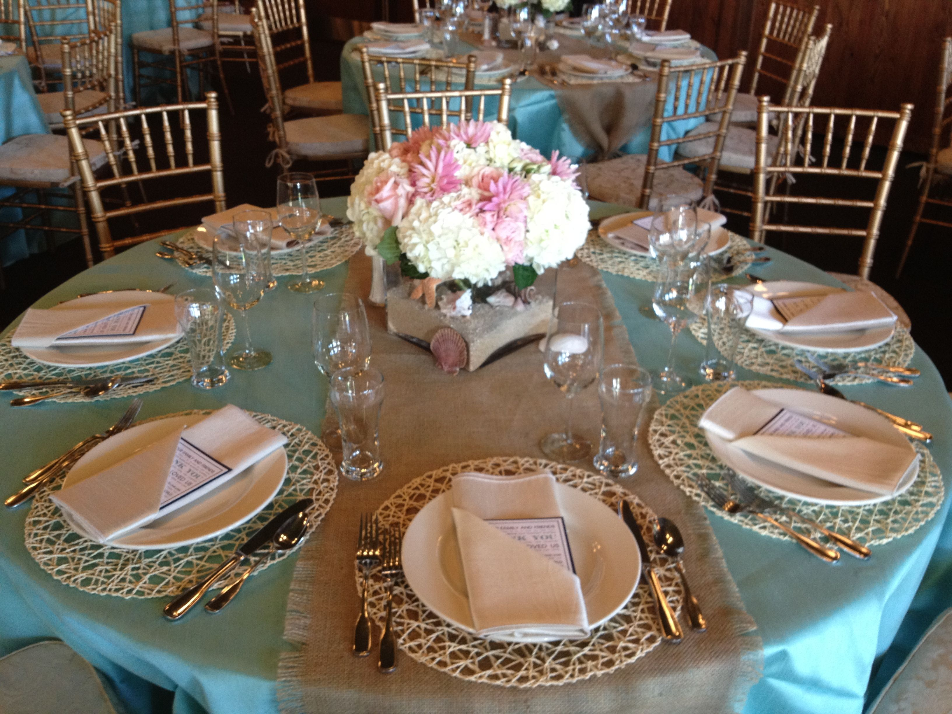 Blue and gold wedding decor  Tiffany blue with a burlap table runner Gold and pastel accents