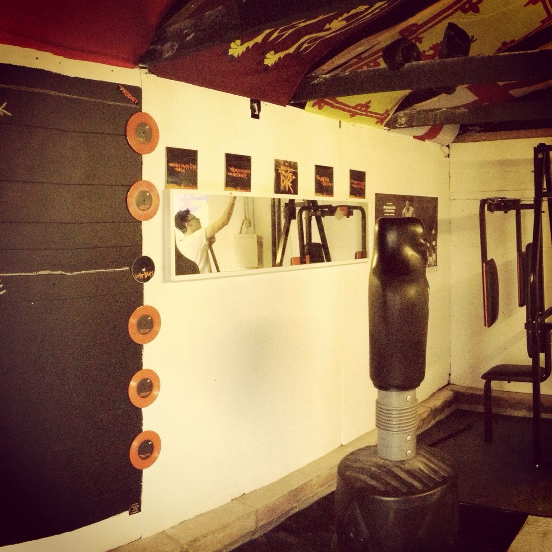 The prodigy tribute on the garage gym wall along with some