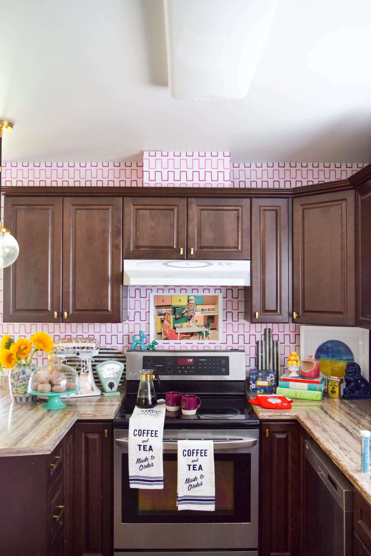 Stove And Cupboards In A Kitchen With Colourful Backsplash
