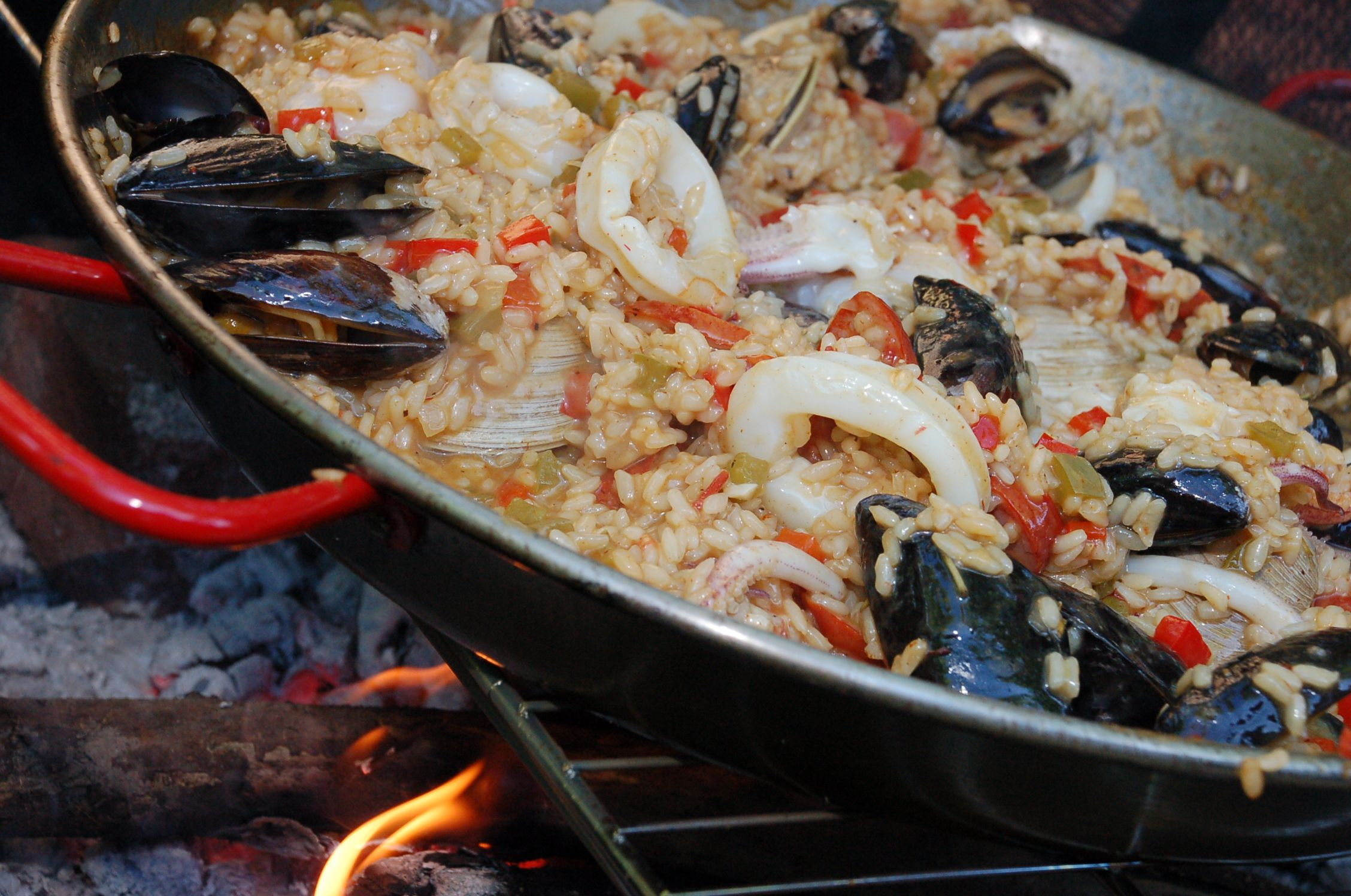 Paella on an open fire. Real food. Real good (poor grammar). Story soon at www.rarerepublic.com.